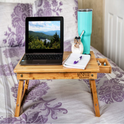 Enjoy working in bed with this sturdy computer desk for bed.