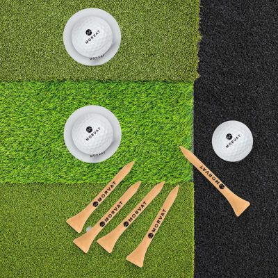 This is an overview of the golf hitting mat open with the balls and tees.