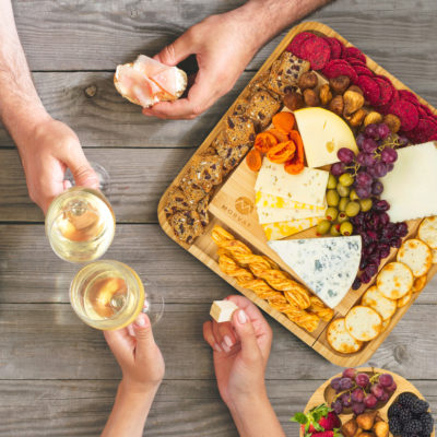 Give this cheese board with cutlery set as the perfect usable gift.